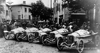 Prior to the 1914 French Grand Prix, the ultimately successful Mercedes team lines up in preparation. Eventual winner LautenschlagerÕs car is second from left.