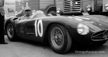 Luigi Musso acclimates himself to the cockpit of his Maserati 300S prior to the start of the 1955 Grand Prix of Bari.