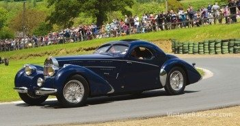 The sleek elegance of a Bugatti Atlantic Type 57SC rounds ÒEttores BendÓ at the Prescott Hillclimb.