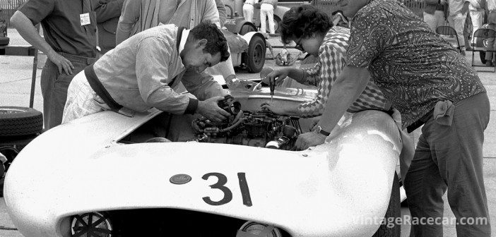 Max and Ina Balchowsky dig into some serious carburetion work on Old Yeller IV in the paddock at Riverside as Wexler looks on.