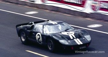 Winning GT40MKII of Bruce McLaren/Chris Amon speeds along the pit straight to complete one of it's 360 laps. 