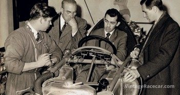 Around a Cooper chassis in 1957 (left to right) are Robinson, Alfred Moss, Stuart Lewis-Evans and Ken Gregory.