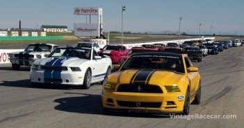 Early and late model Mustangs on the track.