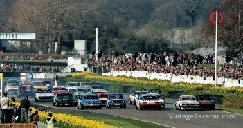 Full field of Õ70s sedans races before a packed house.
