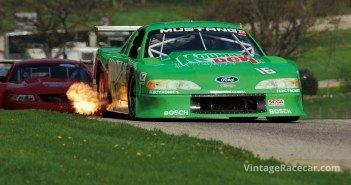 Spitting fire entering Turn 6 is Colin ComerÕs Õ95 Mustang.