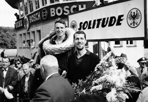 Porsche teammates Dan Gurney and Joakim Bonnier enjoy the chance to stand on the top two steps of the podium after running 1-2 at Solitude in 1962. Photo: Porsche