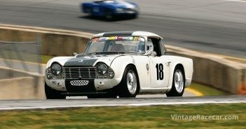 At speed in his 1964 Triumph TR4 is Dennis Delap.