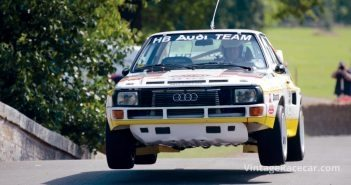 Audi Quattro rally car flies over the humpback bridge.