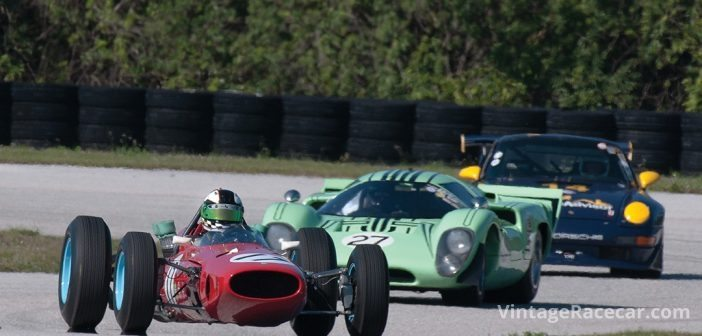 A 1965 Ferrari 1512 F1 leads a 1969 Lola T70 Coupe. Photo: Chuck Andersen
