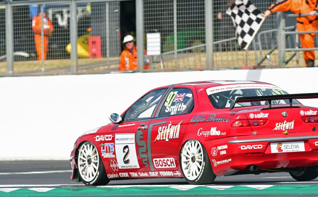 Neil Smith takes the flag in his Super Touring Alfa 156.