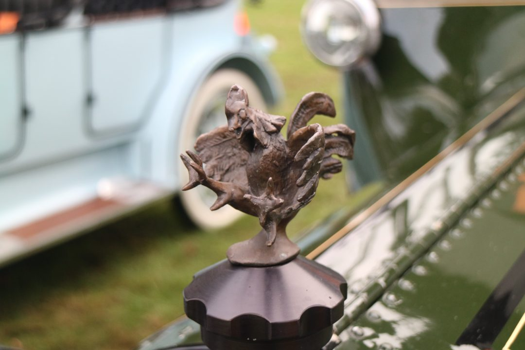 """This mascot appears to be saying """"just don't mess with this 1914 Cadillac!"""""""