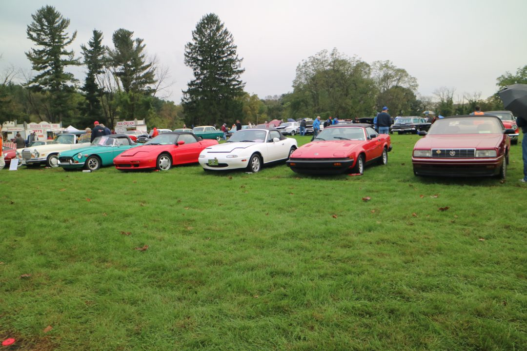 An interesting assortment of sports and sporty cars, from a Cadillac to a Mercedes with three Brits and a Miata in between.