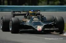 Duncan Dayton, rides up on the curbing in Mario Andretti's 1978 Lotus 79.