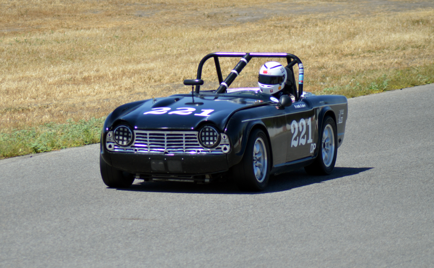 #221 Frank Daley, 1964 TR4, Best Lap: 2:27.263