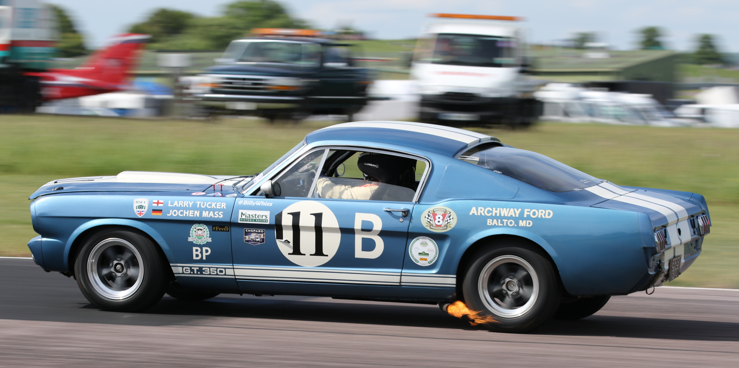Larry Tucker on the overrun in his 1965 Shelby Mustang GT350R. Picasa