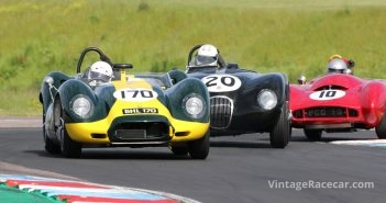Lister Jaguar, C Type Jaguar and Lotus Mk X scrabble over the kerbs. Picasa