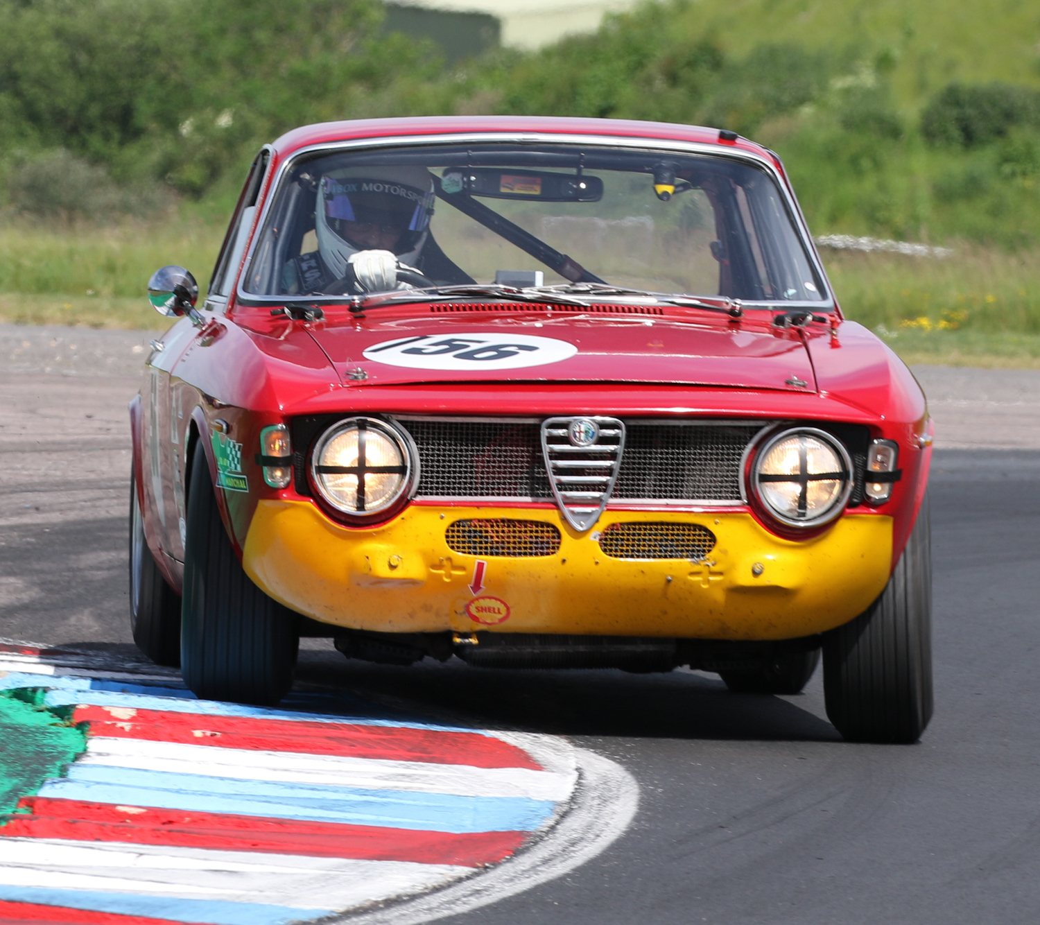 Magnificent car control from David Alexander in his 1966 Alfa Romeo Sprint GT. Picasa