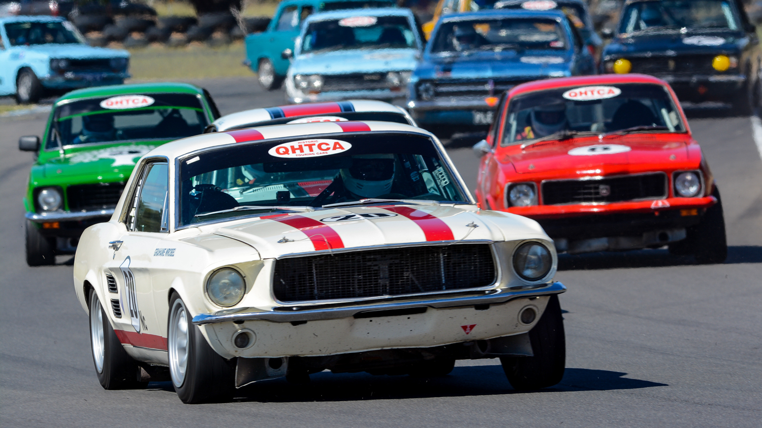 Grahame Wrobel's Mustang leading a gaggle of Group N cars. Ian Welsh