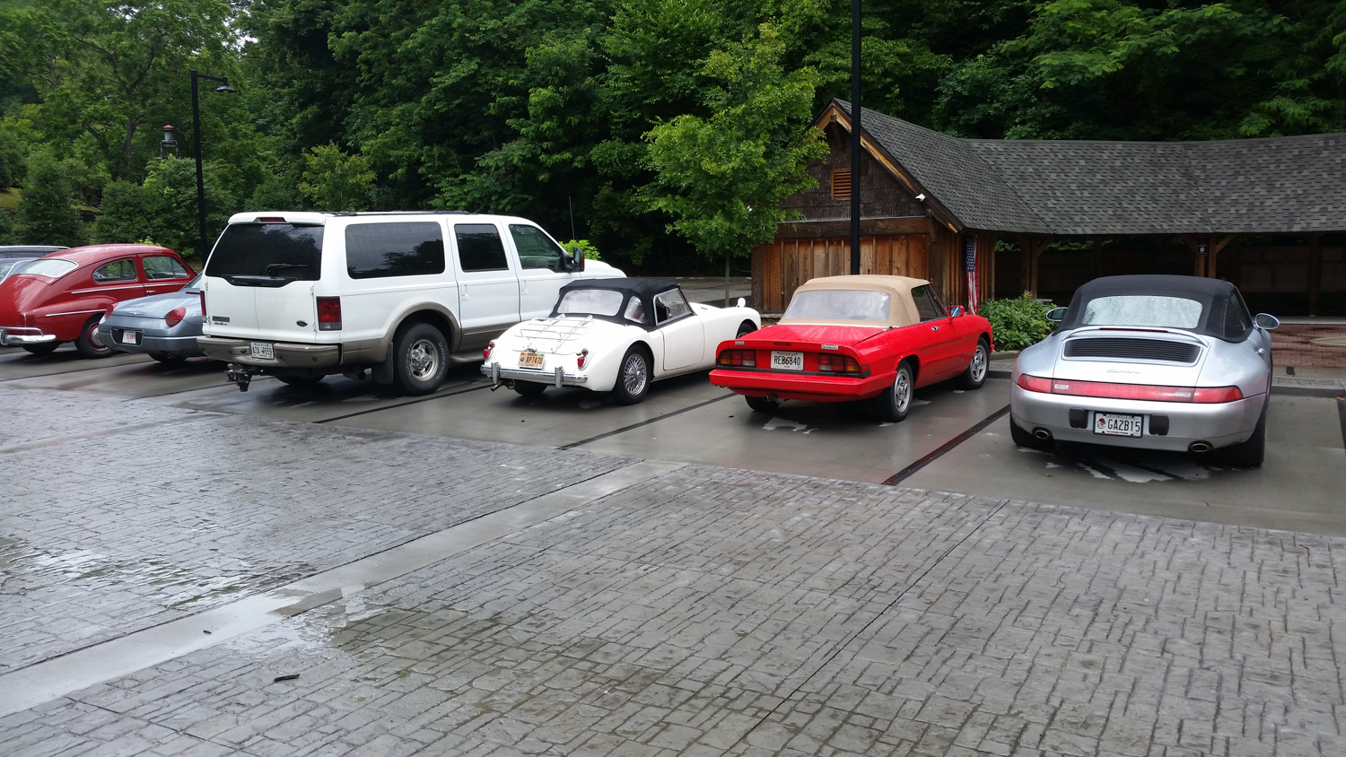 Parking at the Lodge for lunch. Not everyone drove their show car on the tour. The Ford Excursion was driven by a racer - you should see it in the hairpins.
