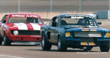The Shelby GT350 of Jim Click leads the Camaro of Bob Scheer.