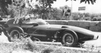 Stirling Moss drives a Vanwall to victory in the Pescara Grand Prix (1957).